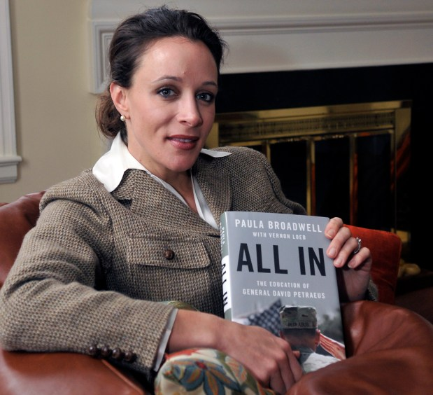 """In this Jan. 15, 2012, file photo, Paula Broadwell, author of the David Petraeus biography """"All In,"""" poses for photos in Charlotte, N.C."""