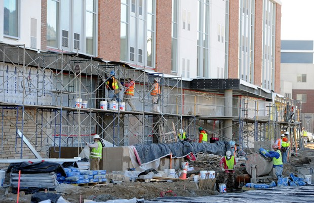Construction crews work on a building project in Boulder in 2014. The Boulder Planning Board recently rejected a housing project that would have provided 50 middle-income housing units on the city's most active transit corridor.