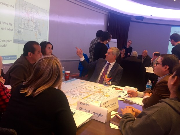 Chris Ryerson, center, from city consultant MIG, leads a table discussion about Denver land-use and transportation needs with Blueprint Denver task force members during a meeting on Dec. 8, 2016, on the Auraria campus.