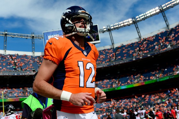 Paxton Lynch (12) of the Denver Broncos warms up before the first quarter. The Denver Broncos hosted the Atlanta Falcons on Sunday, Oct. 9, 2016.