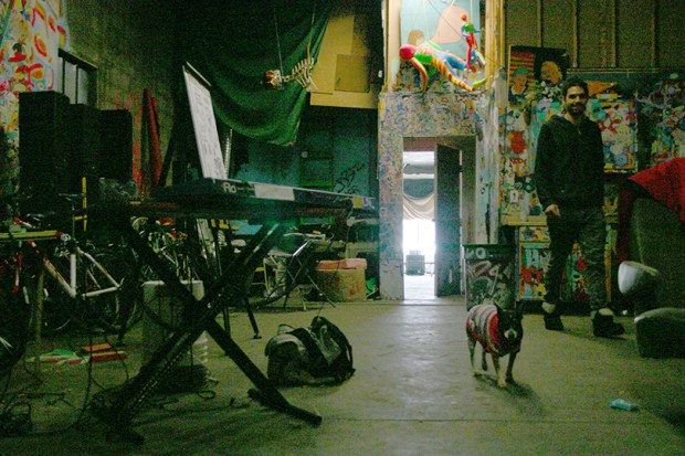 Ignacio Aguerrevere and his dog hang out at Denver's Rhinoceropolis -- a work and gathering space for artists and musicians -- on Jan. 16, 2015. City officials recently evicted several people who were living in the building, in the aftermath of a deadly fire at a similar building in Oakland.