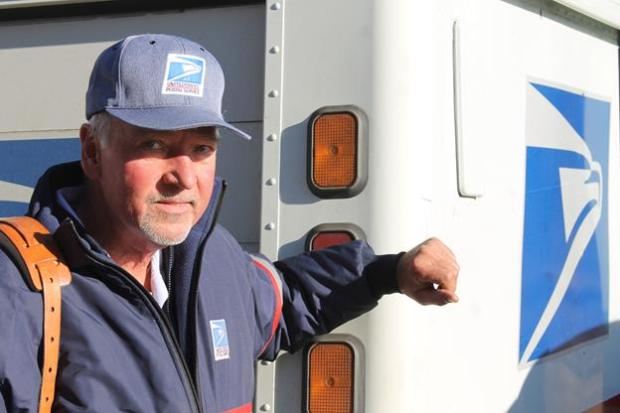 Boulder mail carrier Adrian Helwig is being hailed as a hero after he helped save an 86-year-old man who had fallen in his driveway and was outside in the elements for more than two hours on Dec. 5.