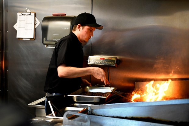 Larkburger employee works the grill