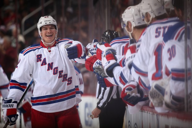 Nick Holden (22) of the New York Rangers celebrates with teammates