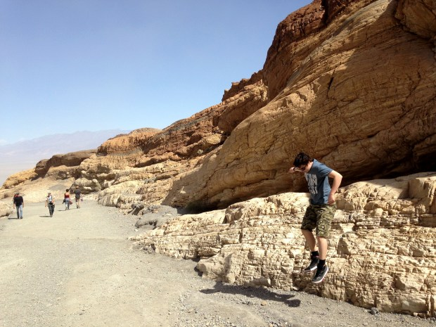 The author's son Luther leaps while scampering on the marble ledges in Mosaic Canyon during a morning hike. The popular Death Valley destination features a 2-mile trail that snakes through the narrows before ending at a dry waterfall.