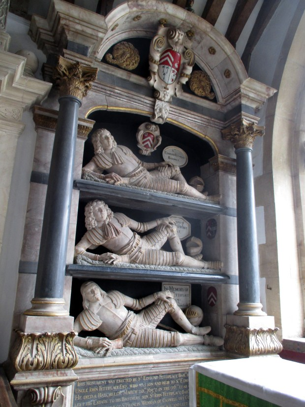 At St. Mary's Church in Swinbrook, England, famous early 17th century effigies show Oxfordshire's prominent Fettiplace family reclining.