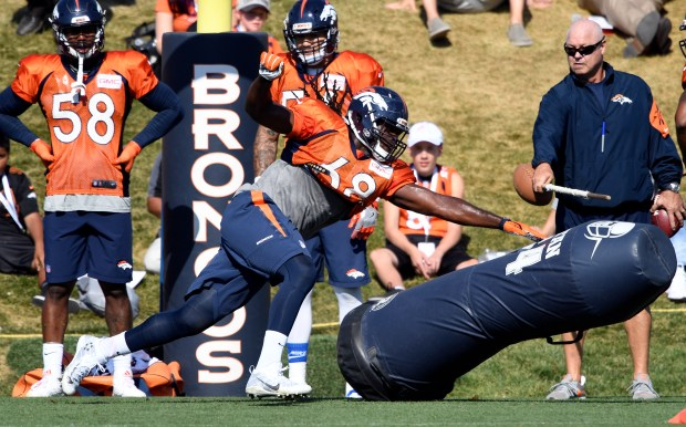 Denver Broncos linebacker Vontarrius Dora (68) runs through drills