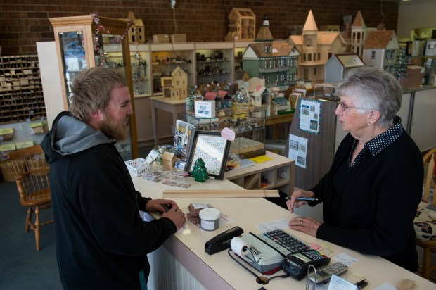 CENTENNIAL, CO - DECEMBER 8: Norma Nielsen rings up Joshua Hayes at Norms Dollhouse in Centennial, Colorado on December 8, 2016. Norm's Dollhouse will be closing in March after 39 years in business. (Photo by Seth McConnell/The Denver Post)
