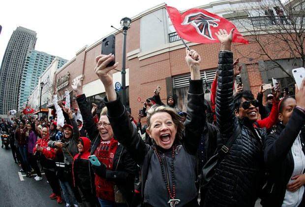 Atlanta Falcons fans cheer their team during a send-off pep rally on Sunday in Atlanta. The Falcons will play the New England Patriots this Sunday in Super Bowl LI.