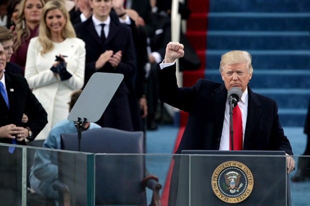 President Donald Trump raises a fist after his inauguration in front of the U.S. Capitol last Friday.