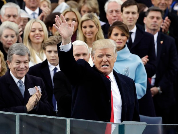 President Donald Trump waves after delivering his inaugural address last Friday in front of the U.S. Capitol.