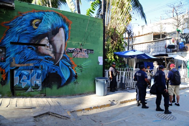 Police guard the entrance of the Blue Parrot nightclub in Playa del Carmen, Mexico, Monday, Jan. 16, 2017. A deadly shooting occurred in the early morning hours outside the nightclub while it was hosting part of the BPM electronic music festival, according to police.