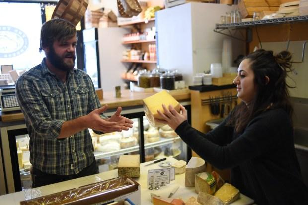 Joe Schwab and Nina Waysdorf work at The Truffle Cheese Shop in Denver, January 05, 2017.