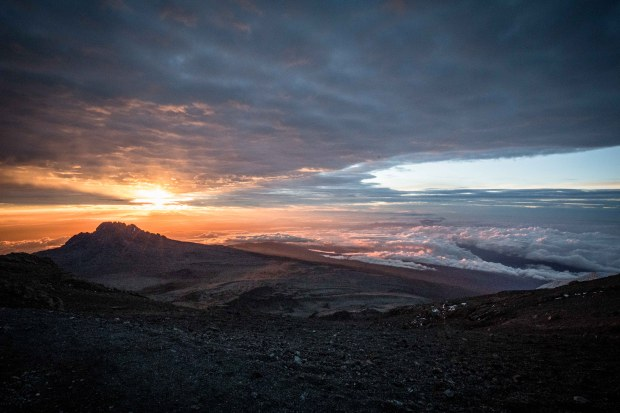 Sunrise from Stellar Point on Mount Kilimanjaro in Tanzania. The team climbed the mountain at night, and sighted members of the group were always surprised to see how far they'd ascended when the sun rose, said Dan Berlin, of Fort Collins.