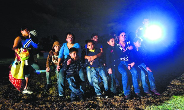 A group of immigrants from Honduras and El Salvador who crossed the U.S.-Mexico border illegally are stopped in Granjeno, Texas on June 25, 2014. The  5-mile slice of deep South Texas that has become a hot spot for migrants, human smugglers and drug cartels.