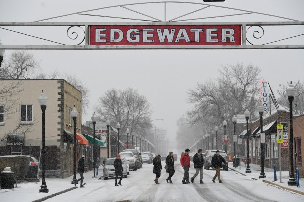 A group of people walks across the street on January 4, 2017 in Edgewater, Colorado.