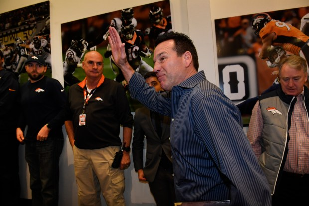 Denver Broncos head coach Gary Kubiak waves to members of his coaching staff, family and members of the media after a press conference where he announced that he will step down as head coach for the Denver Broncos at the UC Health Training Center on January 2, 2017 in Denver, Colorado. Kubiak led the Broncos to 24 victories during his tenure, the most of any coach in his first two seasons including a Super Bowl victory in 2015.