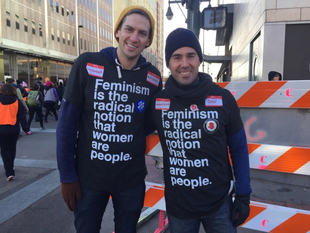 "Former U.S. Ambassador to the Organization for Security & Cooperation in Europe Daniel Baer, right, and Brian Walsh, left, volunteer on Champa Street during the Women's March while wearing shirts with ""Feminism is the radical notion that women are people."""