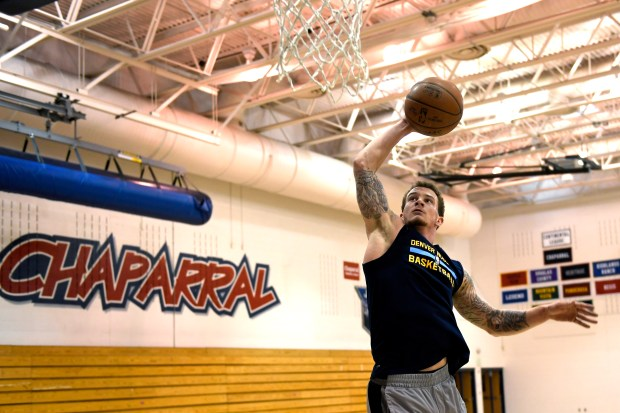 Josh Adams dunks the ball during a workout at Chaparral High School. He is recently back following a serious car accident last August and is signed to play professionally in Russia. January 05, 2017 Parker, CO.