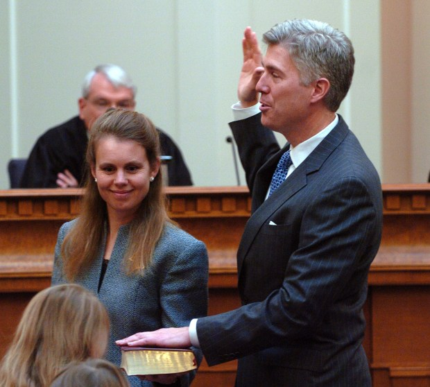 Swearing in of Coloradan Neil M. Gorsuch as the newest member of the United States Court Of Appeals For The Tenth Circuit on Nov. 20, 2006 in Denver, with his wife Louise Gorsuch holding the bible and his two daughters, Belinda Gorsuch, 4, and Emma Gorsuch, 6.