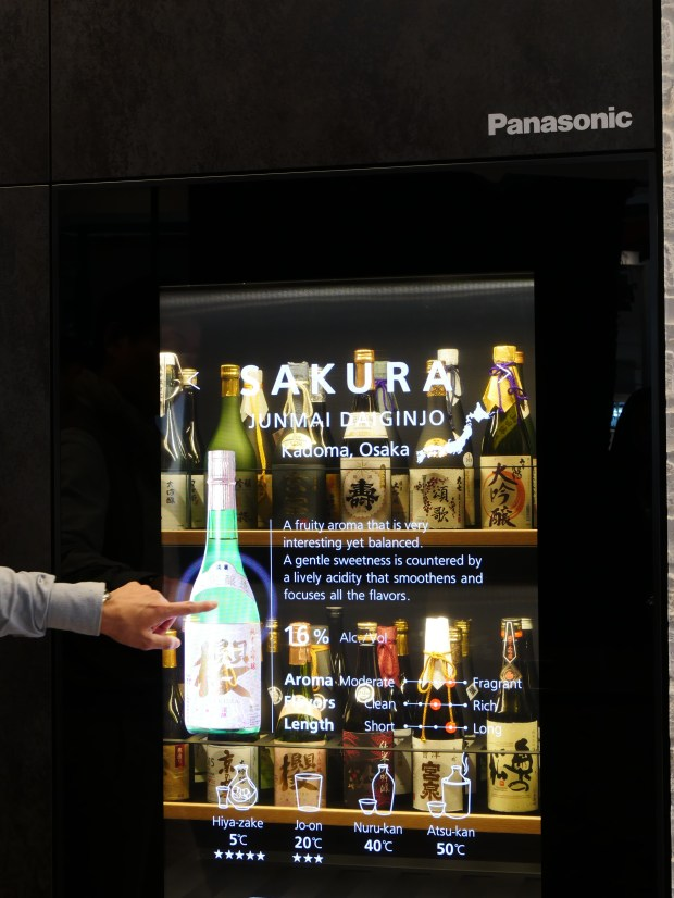 Panasonic's transparent video display is built into a prototype sake fridge. Tap on the clear glass and information about the sake inside shows up.