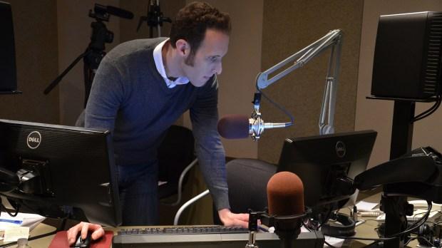 """Ryan Warner, host of """"Colorado Matters,"""" works in the Colorado Public Radio studios."""