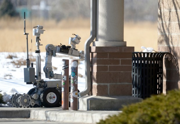 A bomb squad robot approaches a trash can after two objects which looked like pipe bombs were found inside Jan. 18, 2017.