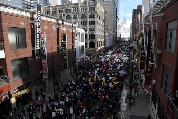 Participants in the Women's March on Denver make their way down Glenarm Place near the 16th Street Mall last Saturday. More than 100,000 people converged on downtown Denver in coordination with demonstrations across the country.