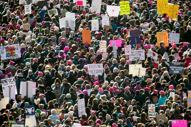 Tens of thousands of people, mostly women, gather in Civic Center for the Women's March on Denver on Saturday.