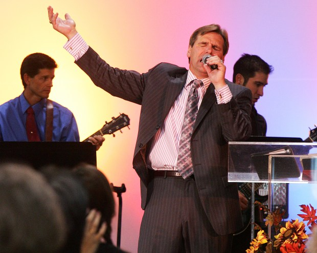 In this 2007 file photo, Pastor Scott VonLanken preaches and sings to those gathered at The Ranch for the Fire on the Front Range Revival Now conference. VonLanken was identified as the victim of a late-night shooting while he was at work as a contract RTD security officer.