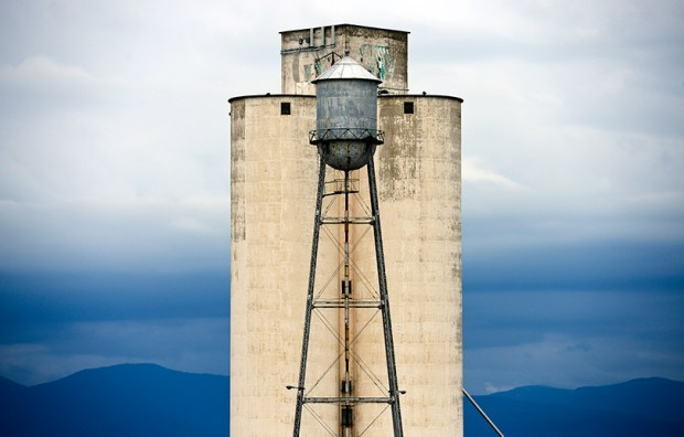 Clouds hang over the mountains behind the Great Western Sugar Company's silos along Sugar Mill Road in Longmont on May 9, 2013.