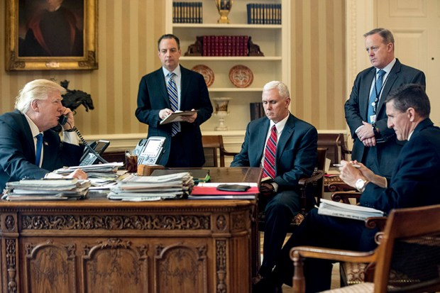 President Donald Trump speaks on the phone with Russian President Vladimir Putin on Jan. 28 from the Oval Office. He is accompanied by Chief of Staff Reince Priebus, Vice President Mike Pence, White House press secretary Sean Spicer and National Security Adviser Michael Flynn.