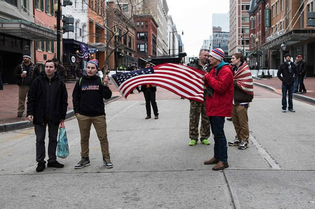 Supporters of Donald Trump hold a flag before his inauguration on Jan. 20 in Washington.
