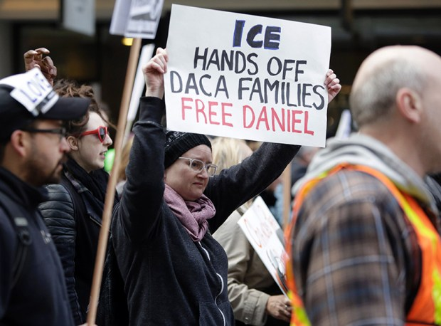 People march to protest the detention of Daniel Ramirez Medina, a Deferred Action for Childhood Arrivals recipient, by U.S. Immigration and Customs Enforcement (ICE) in Seattle on Feb. 17.
