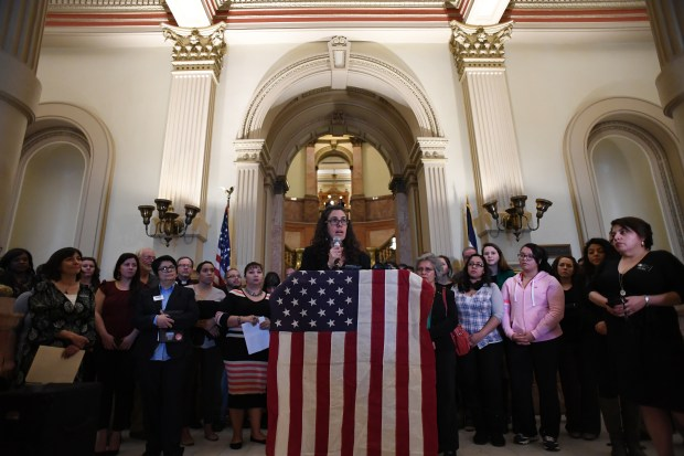 Gabriela Flora, of American Friends Service Committee, speaks against HB17-1134 at the Colorado State Capitol's west foyer, Feb. 22, 2017. Representative Dave Williams from Colorado Springs is introducing the bill.