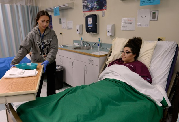 THORNTON, CO - FEBRUARY 23: Student nursing assistants Lorraine Harvey, 18, left, and Nissa Rodriguez, 18, run through their practicum on proper patient mouth care during their morning class at Bollman Technical Education Center on February 23, 2017 in Thornton, Colorado. The Adams 12 Five Star Schools' business services team, in collaboration with the community, are planning and designing a new campus for the technical school that will address current need for additional career and technical education opportunities for students. This is part of the projects outlined in the district's recently passed $350 million bond. (Photo by Kathryn Scott/The Denver Post)