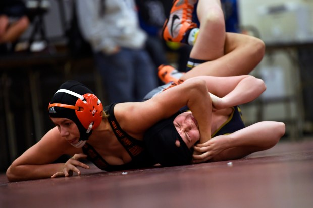 greeley central wrestler kaden campbell picks up back points on her way to a win over brandee greerr of legacy high school during the chatfield high school jv and girl's wrestling tournament jan. 28, 2017 in littleton.