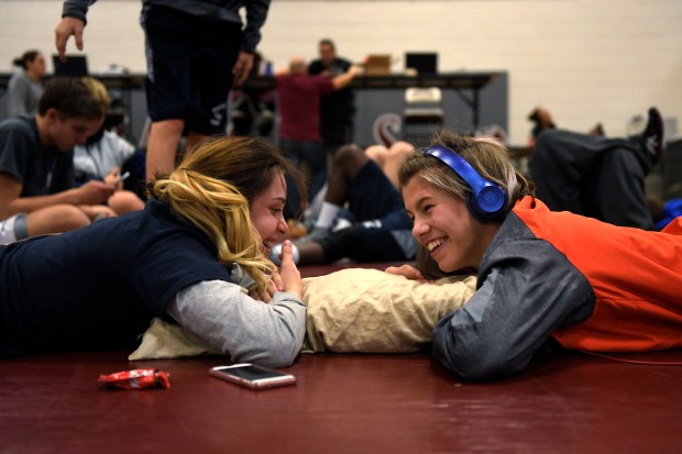 Greeley Central wrestler Kaden Campbell, right, shares a pillow and talks with University Schools wrestler Andrea Perrine at the break during the Chatfield High School JV and girl's wrestling tournament Jan. 28, 2017 in Littleton, CO.