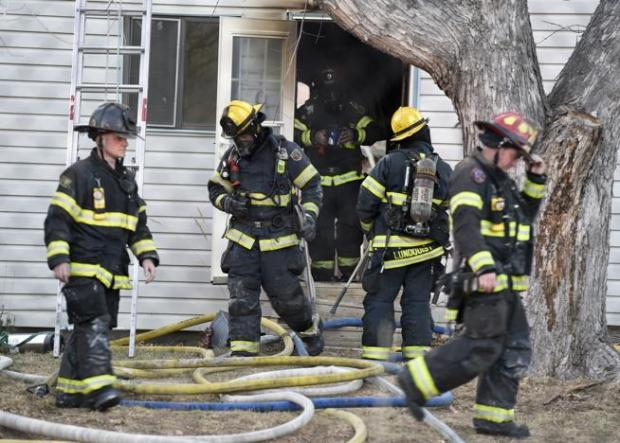 Firefighters work to put out a structure fire on Modred Street in Lafayette.
