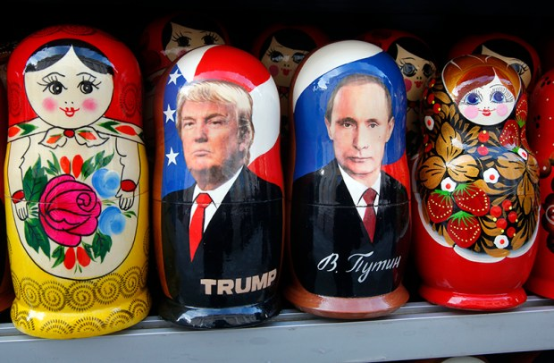 Russian wooden dolls depicting Russian President Vladimir Putin and U.S. President Donald Trump are displayed for sale at a street souvenir shop in St. Petersburg, Russia, on Jan. 20.
