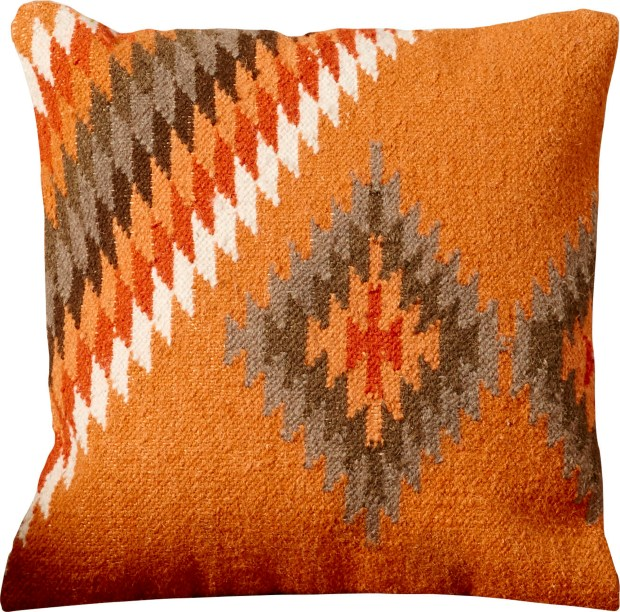 An AllModern pillow using rich, earthy hues and bold geometrics which make for this striking – and sturdy – piece. Kilim rug weaves are trending off the floor, in pillows and upholstery, as part of the global and tribal décor trends.