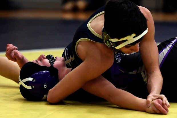 Kaley Barker, Mountain View High School's 113 pound wrestler is pinned by Cruz Jimenez of Frederick High School during the 2017 4A - Region 2 Wrestling Tournament