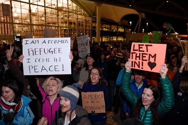 Demonstrators protest President Donald Trump's executive order on immigration on Jan. 28 at Denver International Airport.