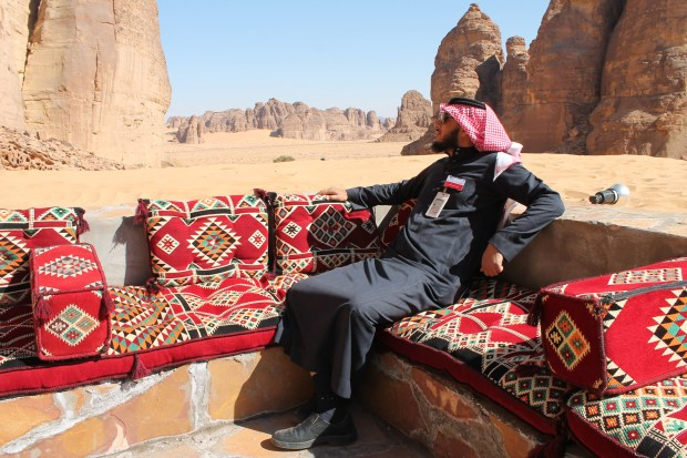 Ahmed Al Imam, a tour guide, relaxes in an outdoor seating area at Shaden, a new luxury 5-star desert camp in Al Ula, Saudi Arabia, on Feb. 1, 2017.