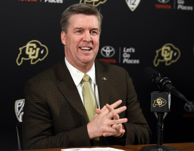 Colorado Buffalo head football coach, Mike MacIntyre, begins to talk about new recruits during the University of Colorado football signing day for high school players. Cliff Grassmick, Daily Camera