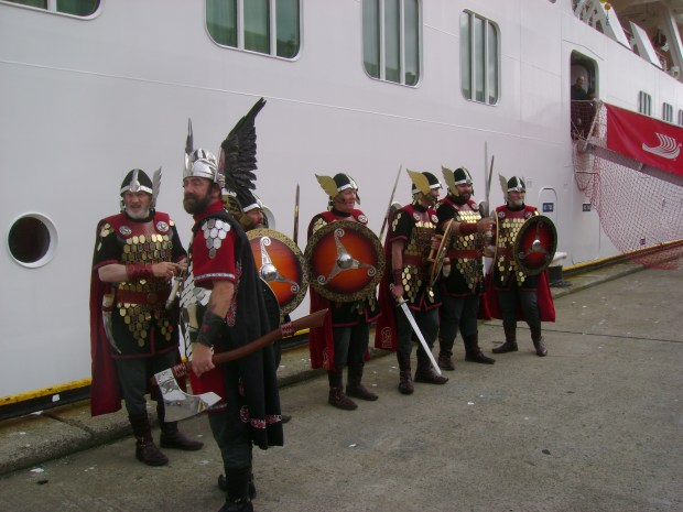 "Locals costumed as Vikings awaiting passengers from the Viking Star cruise ship in Lerwick, Shetland Islands, Scotland, where the ship called during its ""In the Wake of the Vikings"" cruise."