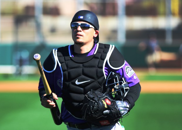 Colorado Rockies catcher Tony Wolters heads to batting practice