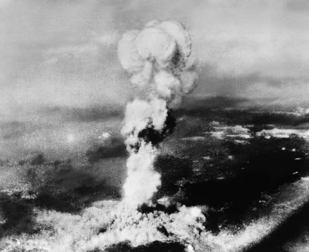 Aug. 6, 1945: This picture made from the town of Yoshiura on the other side of the mountain north of Hiroshima, Japan, shows the smoke rising from the explosion of the atomic bomb at Hiroshima. It was picked up from an Australian engineer at Kure, Japan. Note the radiation spots on the negative caused by the explosion of the A-bomb, almost ruining the film.