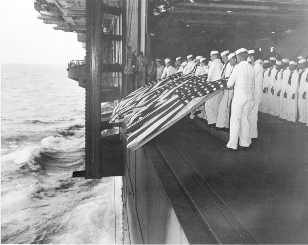 Nov. 26, 1944: Burial at sea ceremonies are held aboard the USS Intrepid for members of the crew lost after the carrier was hit by a Japanese suicide pilot while operating off the coast of Luzon, the Philippines, during World War II. Sixteen men were killed in the kamikaze attack.