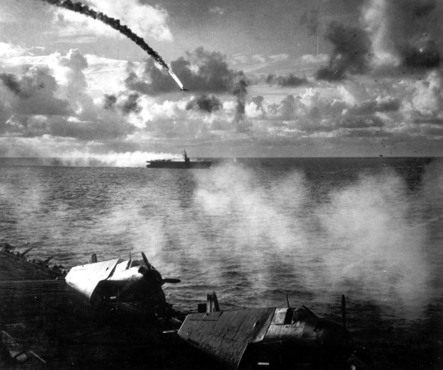 June 1944: A Japanese bomber is shot down as it attempted to attack the USS Kitkun Bay, near the Mariana Islands.